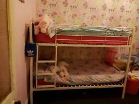 White bunk bed frame.