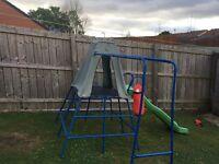 Children's climbing frame with slide
