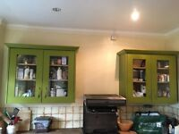 2 matching green kitchen cupboards