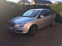 Ford Focus 1.6 Ghia 5dr in very good condition. 57 plate 89000 miles MOT till September 17