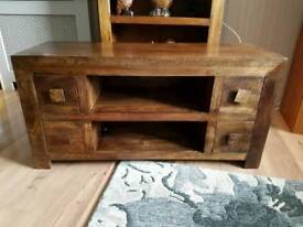 Dark solid wood to view unit.