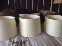 3 cream lampshades.