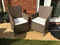 Two Rattan garden chairs