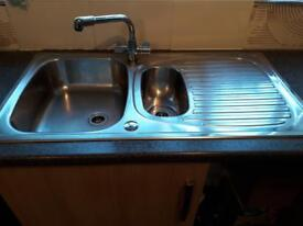 Stainless steel 1 and a half bowl sink and draining board.