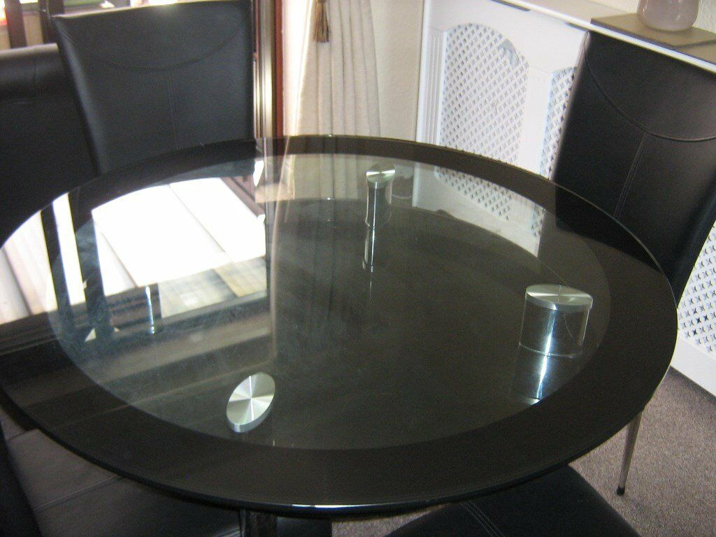Harveys 2 Tier Round Glass Dining Table And 4 Chairs