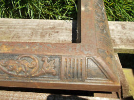 Ornate cast-iron fireplace fender