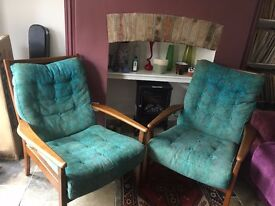 2 upholstered Ercol style arm chairs