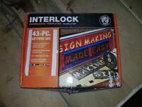 Interlock sign making