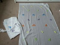 Full length Ikea net curtains, with dragonfly detail and tie backs.