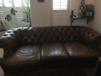 A three seater brown leather sofa