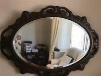 Vintage brown wooden wall mirror