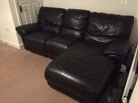 Black Italian leather corner sofa.