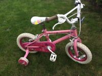 Beautiful pink bike for kids with training wheels in great condition