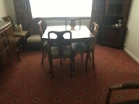 Dining table and 8 chairs, dark wood,