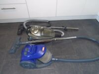 2 cylinder hoovers v 1 is a vax the other is electrolux