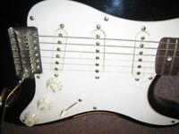 squier strat circa 2005 chinese made wide nut with USA bridge pickup and hard case