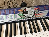 Yamaha electric keyboard for sale, plug-in, still in original packaging.