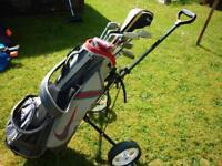 Full set of golf clubs. Wilson di7 irons, Nike driver, odyssey putter, Nike bag & trolley