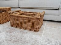set of three wicker baskets with wooden handles