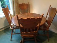 Wooden dinning room table with 4 chairs.