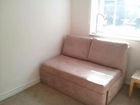 2 seater rarely used beige faux suede sofabed