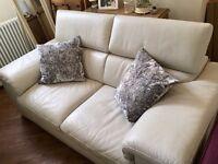 Cream leather Natuzzi sofa in excellent condition