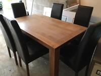 Walnut table and leather chairs