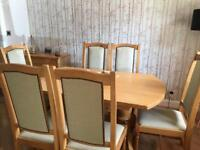 Dining room table and chairs, made of ash with light oak stain