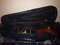 A shroetter Half size violin and case, new strings