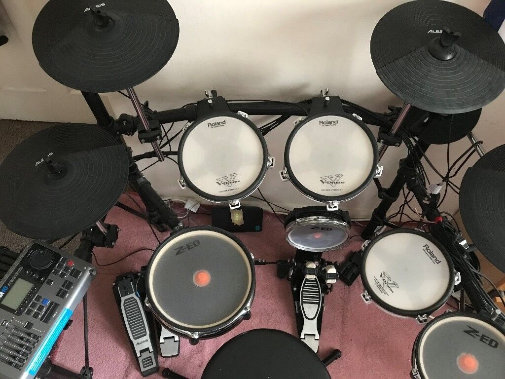 alesis dm10 electronic mesh head drum kit with roland pads in