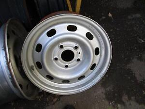 SET OF 4 USED 5 BOLT STEEL RIMS TO FIT A DODGE PICK UP