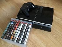 500GB Piano Black Sony Playstation 3 with games