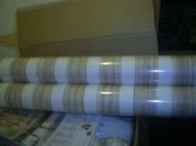 3 Rolls of wallpaper brand new and wrapped