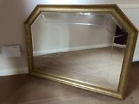 Large gold mirror as new