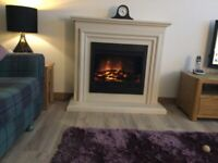 Free standing fireside suite including mantel and surround.