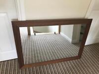 Mirror with dark wood frame