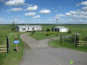 $690,000 - Acreage / Hobby Farm / Ranch in M.D. of Foothills