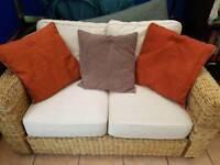 Two wicker sofas
