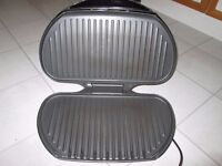 Large George Foreman Grill. Excellent condition.