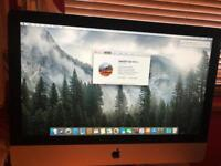 iMac comes with all in photos plus a wireless mouse