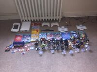 Wii u console with games /Disney infinity characters and games/ lego dimensions