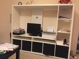 Beautiful TV stand with shelves for other things. Great condition