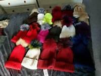 Job lot. 17 bobble hats. 13 bobble scarves. 9 gloves