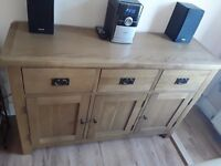 4 MONTH OLD SOLID OAK SIDE BOARD, OPEN TO SENSIBLE OFFERS