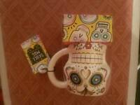 New in packaging Debenhams skull mug with hot chocolate.