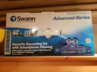 SECURITY CAMERAS.-SWANN DVR4-1200 4 CHANNEL DIGITAL VIDEO RECORDER AND TWO CAMERA. PRO-530