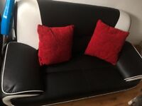 Italian style black leather look sofa