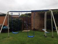 Used blue and white children's swing set.