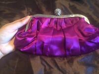 Purple satin clutch bag with diamonte