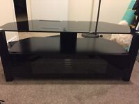 Used glass top Tv Stand
